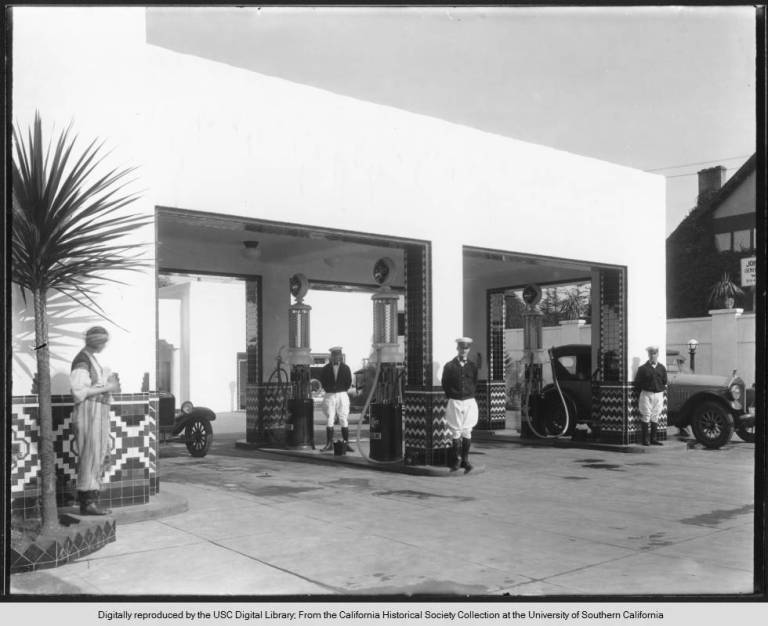 Gas_station_with_Calpet_gasoline_and_uniformed_attendants_ca19201929