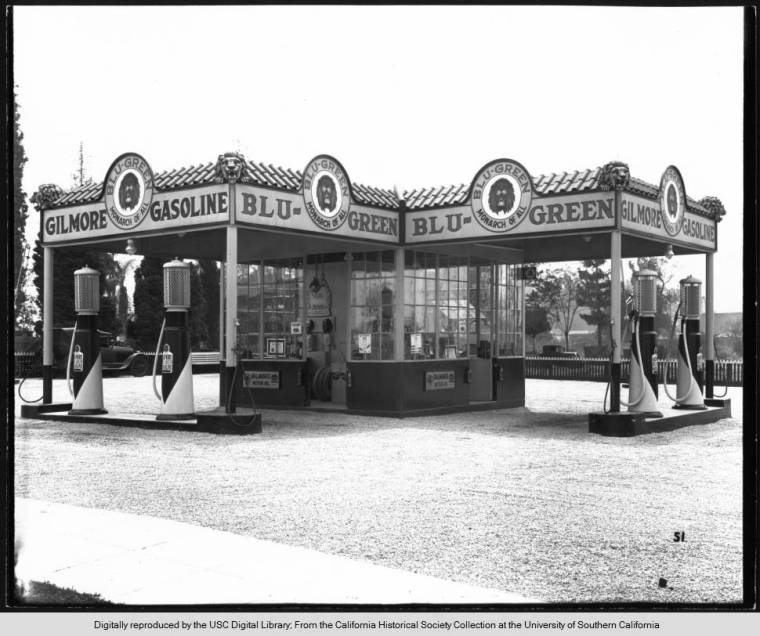 Unidentified_gas_station_advertising_Gilmore_gasoline_ca19201929