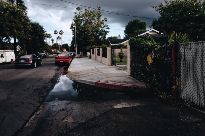 Columbus at Hamlin looking south. During rainy season, puddles form as the street has no sewers to drain rainwater.